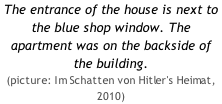 The entrance of the house is next to the blue shop window. The apartment was on the backside of the building. (picture: Im Schatten von Hitler's Heimat, 2010)